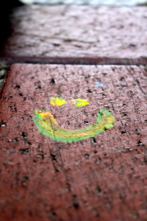 smiley face on brick